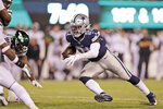 Dallas Cowboys' Ezekiel Elliott, right, runs the ball for a touchdown during the second half of an NFL football game against the New York Jets, Sunday, Oct. 13, 2019, in East Rutherford, N.J. (AP Photo/Adam Hunger)
