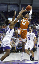 Texas guard Kerwin Roach II (12) shoots against TCU center Russell Barlow (34) as guard Alex Robinson (25) looks on during the first half of an NCAA college basketball game in Fort Worth, Texas, Wednesday, Jan. 23, 2019. (AP Photo/LM Otero)