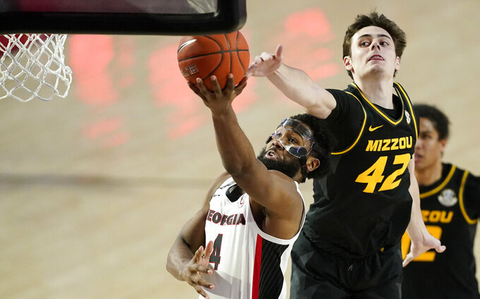 Georgia forward Andrew Garcia (4) shoots as Missouri forward Parker Braun (42) defends during the second half of an NCAA college basketball game Tuesday, Feb. 16, 2021, in Athens, Ga. (AP Photo/Brynn Anderson)