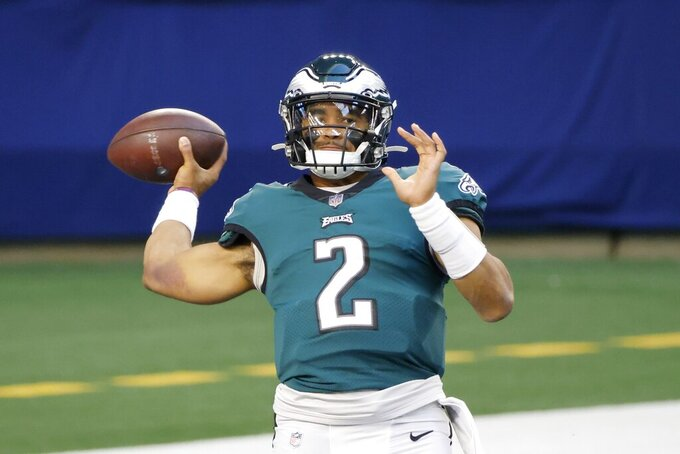 Philadelphia Eagles quarterback Jalen Hurts throws a pass as he warms up before an NFL football game against the Dallas Cowboys in Arlington, Texas, Sunday, Dec. 27. 2020. (AP Photo/Michael Ainsworth)