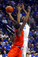 Kentucky's Ashton Hagans, right, shoots while pressured by Auburn's Anfernee McLemore during the first half of an NCAA college basketball game in Lexington, Ky., Saturday, Feb. 29, 2020. (AP Photo/James Crisp)