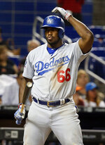 In this Tuesday, May 15, 2018 photo, Los Angeles Dodgers' Yasiel Puig reacts to a strike call during the ninth inning of a baseball game against the Miami Marlins in Miami. One-quarter of the way into the season, the defending NL champion Dodgers are off to their worst start in 60 years. Lately they're even losing to bad teams. (AP Photo/Wilfredo Lee)