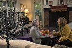 In this Thursday, Oct. 17, 2019, photo, Heba Macksoud, left, of Princeton, N.J., and Sheryl Olitzky, members of the Sisterhood of Salaam Shalom, sit together at Olitzky's home, in North Brunswick, N.J. As the one-year anniversary of Pittsburgh's Tree of Life synagogue attack approaches, and an anti-Semitic shooting in Germany on the holiest day of the Jewish calendar focuses attention anew on the rising tide of global hate crimes against the faith, Jewish and Muslim groups in the U.S. are forging durable alliances in pushing back against crimes targeting their respective communities. (AP Photo/Mel Evans)