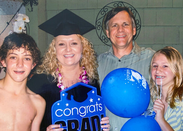 This 2009 photo provided by the Biel family, shows the late Kristen Biel, at her graduation party, with her husband Darryl Biel and their two children, Dylan and Delaney.  On Monday, the Supreme Court will hear arguments in a disability discrimination lawsuit she filed against her former employer, St. James Catholic School in Torrance, California. A judge initially sided with the school and halted the lawsuit, but an appeals court disagreed and said it could go forward. (Biel family photo via AP)