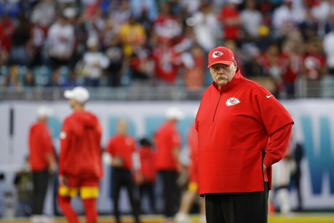 Kansas City Chiefs head coach Andy Reid watches before the NFL Super Bowl 54 football game between the San Francisco 49ers and Kansas City Chiefs Sunday, Feb. 2, 2020, in Miami Gardens, Fla. (AP Photo/Patrick Semansky)