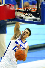Creighton's Christian Bishop (13) dunks against Nebraska during the second half of an NCAA college basketball game in Omaha, Neb., Friday, Dec. 11, 2020. (AP Photo/Nati Harnik)