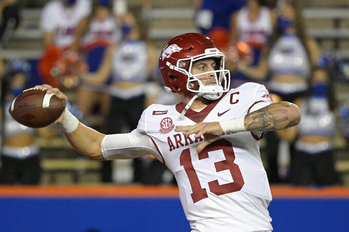 Arkansas quarterback Feleipe Franks (13) warms up before an NCAA college football game against Florida, Saturday, Nov. 14, 2020, in Gainesville, Fla. (AP Photo/Phelan M. Ebenhack)