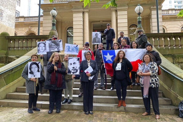 Supporters of those who disappeared in Chile in the 1970's are seen outside the Sydney Central Local Court in Sydney, Thursday, Oct. 29, 2020.An Australian judge has ruled that a woman wanted in Chile on kidnapping charges dating to Augusto Pinochet's military dictatorship in the 1970s can be extradited. (Margaret Scheikowski, AAP Image via AP)