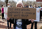 Cat McKay of Alexandria, Va., holds a sign during a protest organized by
