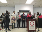 """FILE – In this Sept. 27, 2016, file photo, Adrienne Hood speaks about her son, Henry Green, as relatives, attorneys and others look on at a news conference in Columbus, Ohio. The announcement that the U.S. Justice Department will provide technical assistance to the Columbus police department at the city's invitation has done little to curb community activists' anger. On Thursday, Sept. 16, 2021 they asked the Justice Department to launch an investigation through its Civil Rights Division, a probe sometimes called a """"pattern and practices"""" investigation that can lead to court-ordered oversight of a troubled police department. (AP Photo/Ann Sanner, File)"""