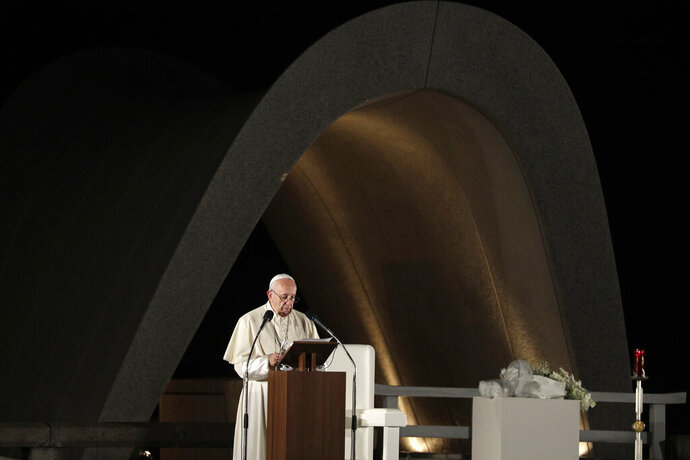 FILE - In this Nov. 24, 2019 file photo, Pope Francis delivers a speech in front of the Memorial Cenotaph at Hiroshima Peace Memorial Park in Hiroshima, western Japan. Pope Francis on Thursday, Aug. 6, 2020 marked the 75th anniversary of the nuclear attack on Hiroshima by calling for peace and repeating that not only the use of atomic weapons but their mere possession is immoral. (AP Photo/Gregorio Borgia, file)