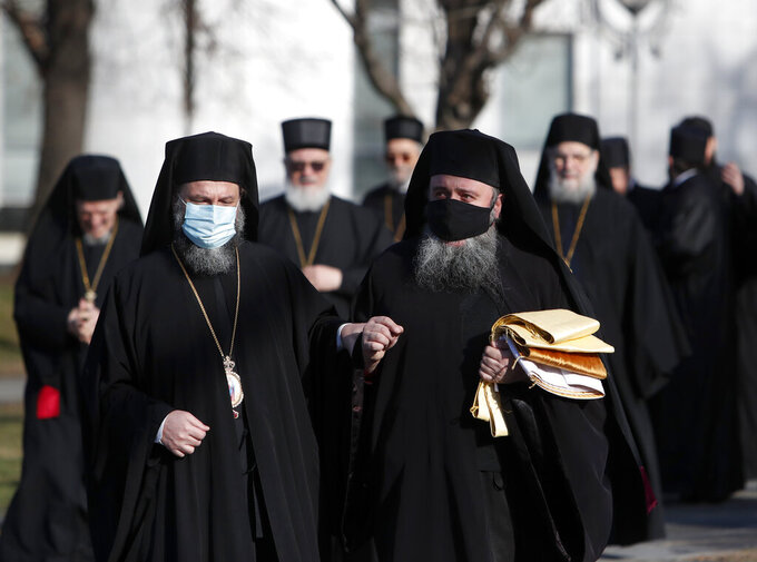 Serbian Orthodox Church bishops arrive in the St. Sava temple before church closed session in Belgrade, Serbia, Thursday, Feb. 18, 2021. The Serbian Orthodox Church gathers in closed session to pick a new Patriarch, following the death of old one Irinej. Irinej died last year of COVID, following the outbreak of virus among church officials in Belgrade. (AP Photo/Darko Vojinovic)