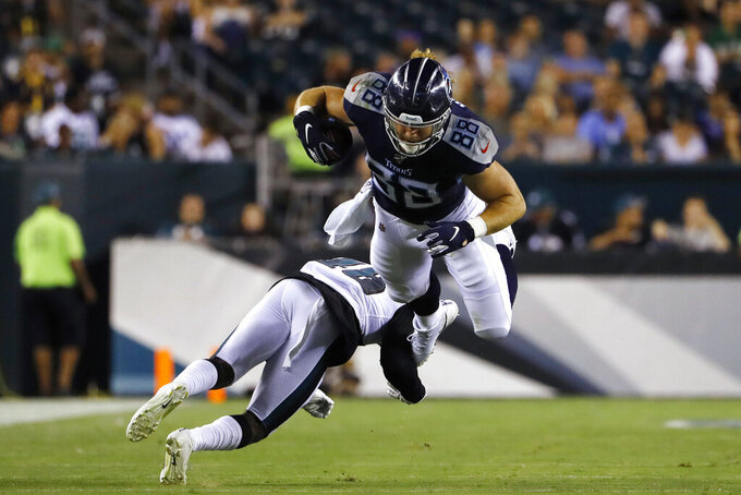 Tennessee Titans' Ryan Hewitt, top, is tackled by Philadelphia Eagles' Josh Hawkins during the second half of a preseason NFL football game Thursday, Aug. 8, 2019, in Philadelphia. (AP Photo/Matt Rourke)