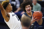 Washington State forward CJ Elleby, right, drives to the rim as Colorado guard D'Shawn Schwartz defends in the first half of an NCAA college basketball game Thursday, Jan. 23, 2020, in Boulder, Colo. (AP Photo/David Zalubowski)