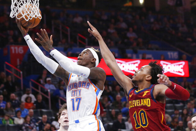 Oklahoma City Thunder guard Dennis Schroeder (17) shoots in front of Cleveland Cavaliers guard Darius Garland (10) during the first half of an NBA basketball game Wednesday, Feb. 5, 2020, in Oklahoma City. (AP Photo/Sue Ogrocki)