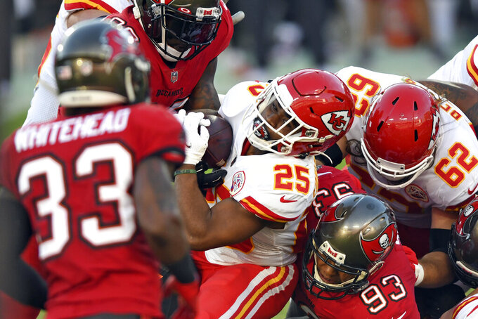 Kansas City Chiefs running back Clyde Edwards-Helaire (25) finds a hole in the Tampa Bay Buccaneers defense during the first half of an NFL football game Sunday, Nov. 29, 2020, in Tampa, Fla. (AP Photo/Jason Behnken)