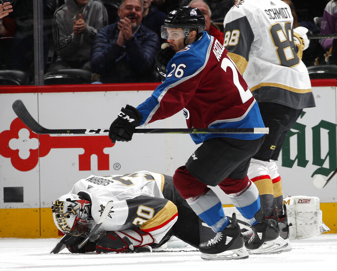 Colorado Avalanche left wing Andrew Agozzino, front, reacts after scoring a goal as Vegas Golden Knights goaltender Malcolm Subban reacts in the second period of an NHL hockey game Monday, Feb. 18, 2019, in Denver. (AP Photo/David Zalubowski)