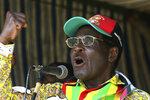FILE - In this Tuesday, March 18, 2008 file photo, Zimbabwe President Robert Mugabe addresses party supporters at a rally in Gweru, about 250 kms. (155 miles) south of Harare. On Friday, Sept. 6, 2019, Zimbabwe President Emmerson Mnangagwa said his predecessor Robert Mugabe, age 95, has died. (AP Photo/Tsvangirayi Mukwazhi, file)