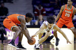Kansas State's Mike McGuirl, front right, and Florida A&M's Nasir Core, left, chase the ball during the first half of an NCAA college basketball game Monday, Dec. 2, 2019, in Manhattan, Kan. (AP Photo/Charlie Riedel)