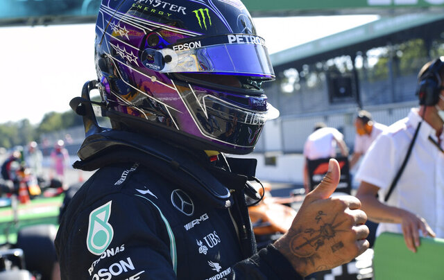 Mercedes driver Lewis Hamilton of Britain celebrates after clocking the fastest time during the qualifying session for Sunday's Italian Formula One Grand Prix, at the Monza racetrack in Monza, Italy, Saturday, Sept. 5, 2020. (Jennifer Lorenzini/Pool via AP)