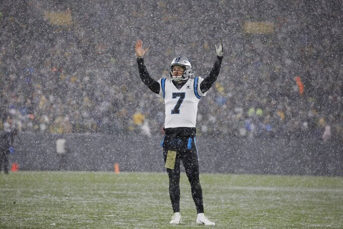 Carolina Panthers' Kyle Allen reacts after a review of the final play of an NFL football game against the Green Bay Packers Sunday, Nov. 10, 2019, in Green Bay, Wis. The Packers won 24-16. (AP Photo/Jeffrey Phelps)