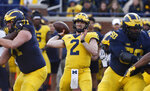 FILE- In this April 13, 2019, file photo, Michigan quarterback Shea Patterson (2) throws during the team's annual spring NCAA college football game in Ann Arbor, Mich. Patterson is back as Michigan's starting quarterback, directing a new offense that is very familiar to him. The senior said the no-huddle, hurry-up offense scheme the seventh-ranked Wolverines will unveil in their opener Saturday against Middle Tennessee is a lot like the one he ran for two years at Ole Miss. (AP Photo/Carlos Osorio, File)