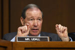 Sen. Tom Udall, D-N.M., asks a question of Boeing Company President and Chief Executive Officer Dennis Muilenburg on Capitol Hill in Washington, Tuesday, Oct. 29, 2019, during a Senate Transportation Committee hearing on
