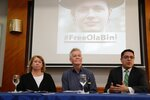 The parents of detained Swedish programmer Ola Bini, Gorel Bini, left and Dag Gustafsson, hold a press conference with their son's lawyer Carlos Soria, in Quito, Ecuador, Tuesday, April 16, 2019. The ace Swedish programmer who was an early, ardent supporter of WikiLeaks was arrested in Ecuador last week in an alleged plot to blackmail the country's president over his abandonment of Julian Assange. (AP Photo/Dolores Ochoa)