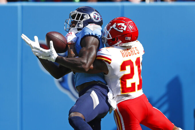 Tennessee Titans wide receiver A.J. Brown, left, catches a touchdown pass as he is defended by Kansas City Chiefs cornerback Mike Hughes (21) in the first half of an NFL football game Sunday, Oct. 24, 2021, in Nashville, Tenn. (AP Photo/Wade Payne)