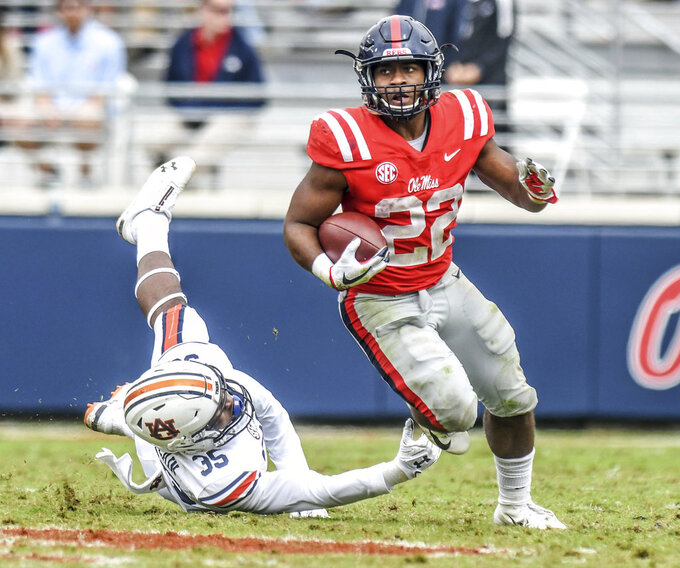 Mississippi running back Scottie Phillips (22) runs away from Auburn linebacker Tanner Dean (35) during an NCAA college football game at Vaught-Hemingway Stadium in Oxford, Miss., Saturday, Oct. 20, 2018. (Bruce Newman/The Oxford Eagle via AP)
