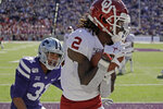 Oklahoma wide receiver CeeDee Lamb (2) catches a pass in the end zone under pressure from Kansas State defensive back Jahron McPherson (31) to score a touchdown during the second half of an NCAA college football game Saturday, Oct. 26, 2019, in Manhattan, Kan. Kansas State won 48-41. (AP Photo/Charlie Riedel)