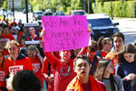 Hundreds of students from Miami Country Day, a private school in Miami Shores, Fla., take to the streets in the national students school walkout protesting gun violence and honoring the 17 students and teachers that were killed last month at Marjory Stone Douglas High School on Wednesday, Feb. 14, 2018, in Parkland, Fla.  (C.M. Guerrero/Miami Herald via AP)