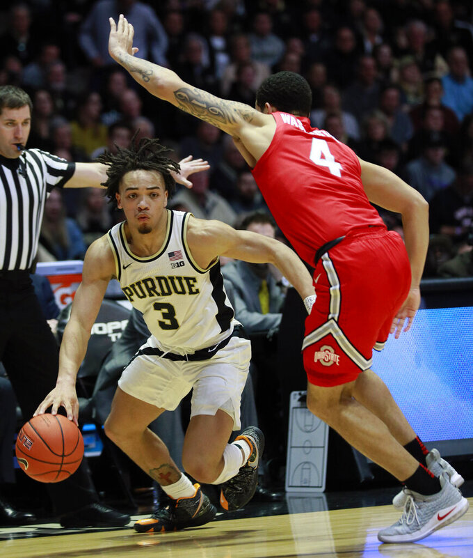 Purdue guard Carsen Edwards (3) controls the basketball guarded by Ohio State guard Duane Washington in the second half of an NCAA college basketball game, Saturday, March 2, 2019, in West Lafayette, Ind. Purdue won 86-51. (AP Photo/R Brent Smith)