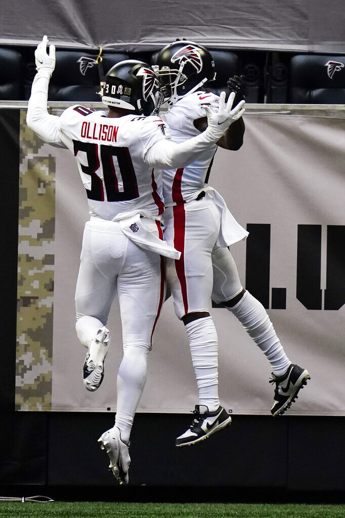Atlanta Falcons running back Qadree Ollison (30) celebrates the touchdown by Atlanta Falcons wide receiver Olamide Zaccheaus (17) during the first half of an NFL football game against the Denver Broncos, Sunday, Nov. 8, 2020, in Atlanta. (AP Photo/Brynn Anderson)