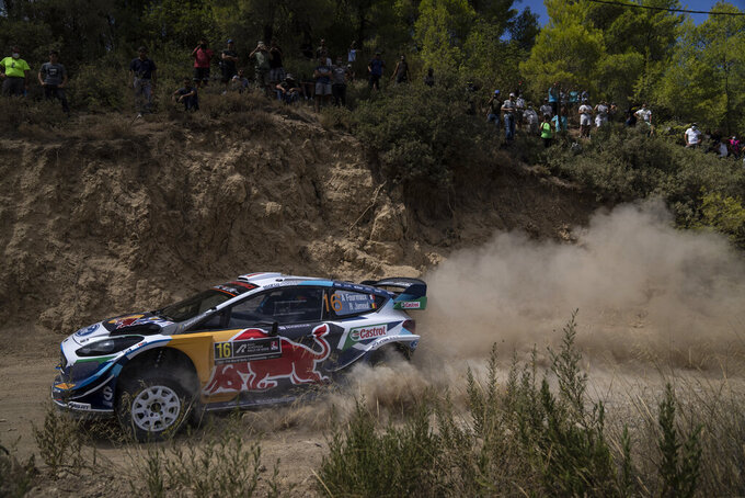 Adrien Fourmaux of France with his co driver Renaud Jamoul of Belgium with their Ford Fiesta WRC car compete in the WRC Acropolis Rally at the stage of Aghii Theodori, west of Athens, on Friday, Sept. 10, 2021. The World Rally Championship returned to Greece after an eight-year absence. (AP Photo/Petros Giannakouris)