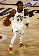 Donovan Mitchell of the Utah Jazz dribbles the ball during the second halfof Game 5 of an NBA basketball first-round playoff series, Tuesday, Aug. 25, 2020, in Lake Buena Vista, Fla. (Mike Ehrmann/Pool Photo via AP)