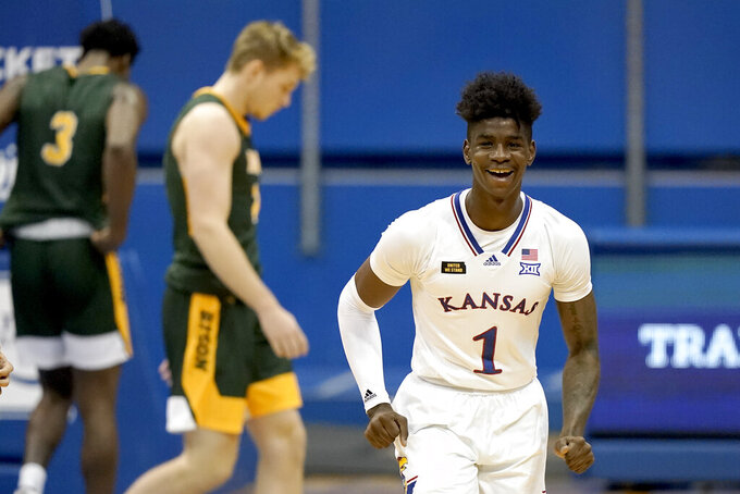 Kansas' Tyon Grant-Foster (1) celebrates after the team's NCAA college basketball game against North Dakota State on Saturday, Dec. 5, 2020, in Lawrence, Kan. Kansas won 65-61. (AP Photo/Charlie Riedel)