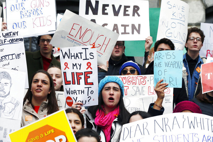 Boston area high school students rally on the steps of the Statehouse in Boston, Wednesday, March 14, 2018. As part of a nationwide school walkout, students from several Boston area schools, closed after Tuesday's snowstorm, marched from a downtown church to the Statehouse to urge lawmakers to pass legislation aimed at stemming gun violence. (AP Photo/Michael Dwyer)