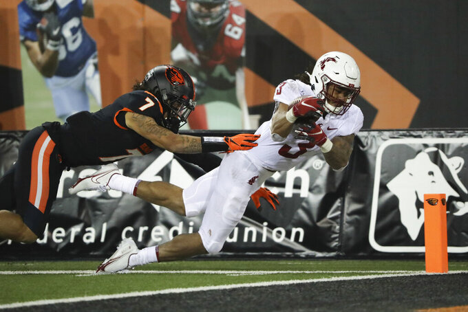 Washington State running back Deon McIntosh (3) dives into the end zone past Oregon State defensive back Alton Julian (7) during the second half of an NCAA college football game in Corvallis, Ore., Saturday, Nov. 7, 2020. Washington State won 38-28. (AP Photo/Amanda Loman)