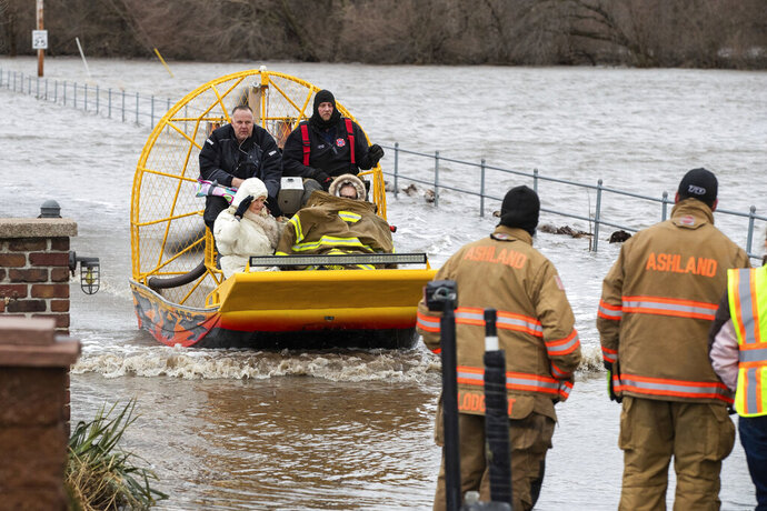 Mary Roncka and her husband Gene Roncka, right, accompanied by neighbor Kevin Mandina are evacuated as floodwaters rise Thursday, March 13, 2019, in Ashland, Neb. Evacuations forced by flooding have occurred in several eastern Nebraska communities, as western Nebraska residents struggled with blizzardlike conditions. (Brendan Sullivan/Omaha World-Herald via AP)