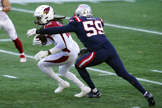 Arizona Cardinals wide receiver DeAndre Hopkins runs from New England Patriots linebacker Terez Hall after catching a pass in the first half of an NFL football game, Sunday, Nov. 29, 2020, in Foxborough, Mass. (AP Photo/Elise Amendola)
