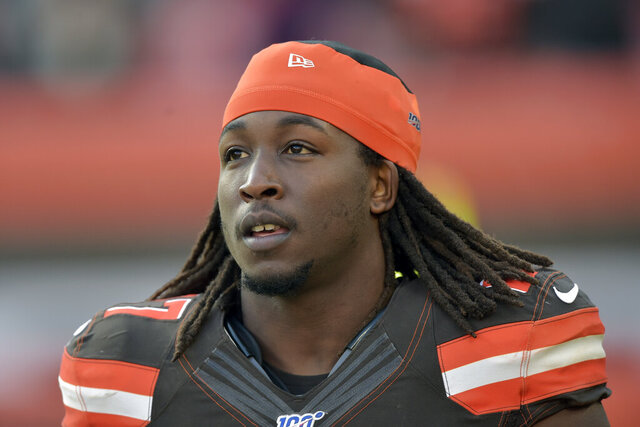 FILE - In this Nov. 24, 2019, file photo, Cleveland Browns running back Kareem Hunt walks on the field at halftime of an NFL football game against the Miami Dolphins, in Cleveland. Browns running back Kareem Hunt was cited for a traffic violation on Tuesday, Jan. 21, 2020, in Rocky River, Ohio and during the stop police officers found marijuana in his vehicle. (AP Photo/David Richard, File)