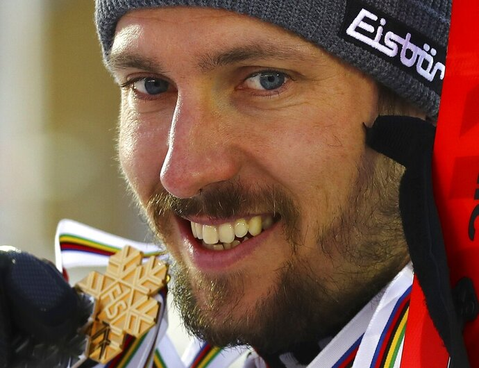 Austria's Marcel Hirscher shows the gold and silver medals of the men's slalom and giant slalom, at the alpine ski World Championships in Are, Sweden, Sunday, Feb. 17, 2019. (AP Photo/Marco Trovati)