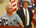 Mike Pagano, brother of Linda Pagano, answers questions as Dr. Thomas P. Gilson Cuyahoga County Medical Examiner listens in the background during a news conference updating the Linda Pagano case at the Cuyahoga County Medical Examiner's office on Thursday, July 12, 2018, in Cleveland, Ohio. Authorities said DNA testing and perseverance have led to the identity of Pagano, a 17-year-old Ohio girl who went missing 44 years ago and whose remains were found in an unmarked grave. Police said that Pagano's missing persons case is now a homicide investigation. (Mike Cardew/Akron Beacon Journal via AP)