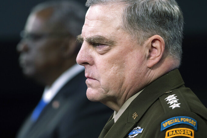 Joint Chiefs Chairman Gen. Mark Milley, right, and Defense Secretary Lloyd Austin take part in a press briefing at the Pentagon, Wednesday, July 21, 2021 in Washington. (AP Photo/Kevin Wolf)