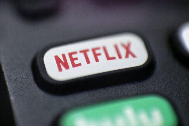 FILE - This Aug. 13, 2020  photo shows a logo for Netflix on a remote control in Portland, Ore. Netflix Inc. (NFLX) on Tuesday, Oct. 20, 2020 reported third-quarter net income of $790 million. The Los Gatos, California-based company said it had profit of $1.74 per share. (AP Photo/Jenny Kane, File)