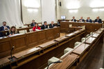 Members of the Senate commission on parliamentary immunity meet to decide wether to lift immunity to Lega party leader Matteo Salvini to put him on trial for alleged kidnapping for keeping migrants aboard a rescue ship when he was interior minister, in Rome, Monday, Jan. 20, 2020. Salvini insists he acted to safeguard Italy's borders when he refused for six days to allow the coast guard ship Gregoretti bring 131 rescued migrants ashore to Sicily in July 2019.  (Roberto Monaldo/LaPresse via AP)