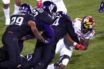 Maryland wide receiver DeJuan Ellis, right, is tackled by Northwestern defenders during the second half of an NCAA college football game in Evanston, Ill., Saturday, Oct. 24, 2020. (AP Photo/Nam Y. Huh)