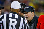Ohio State coach Ryan Day questions the referee about the lack of a call on an Ohio State punt return during the first quarter of the team's NCAA college football game against Minnesota on Thursday, Sept. 2, 2021, in Minneapolis. (AP Photo/Bruce Kluckhohn)