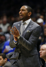 Butler head coach LaVall Jordan cheers his team against Xavier during the first half of an NCAA college basketball game, Saturday, March 7, 2020, in Cincinnati. (AP Photo/Gary Landers)